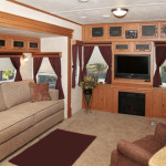 Living area slide-out w/hide-a-bed sofa, entertainment center & fireplace