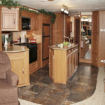 Island kitchen slide-out with sink, stove, refrigerator, pantry and entertainment center